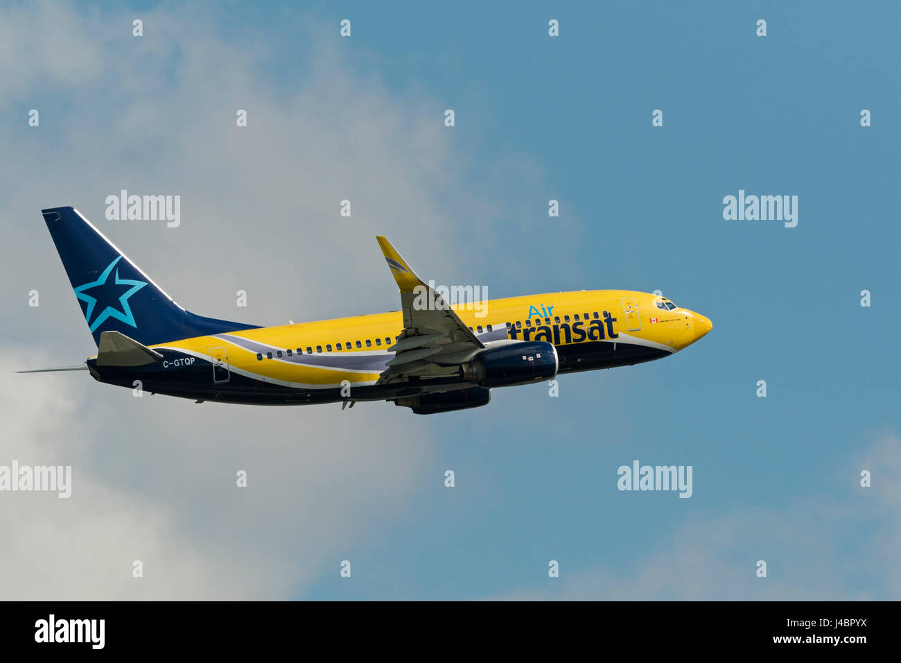 Air Transat plane airplane Boeing 737 airborne after take taking off  Vancouver International Airport - Stock Image