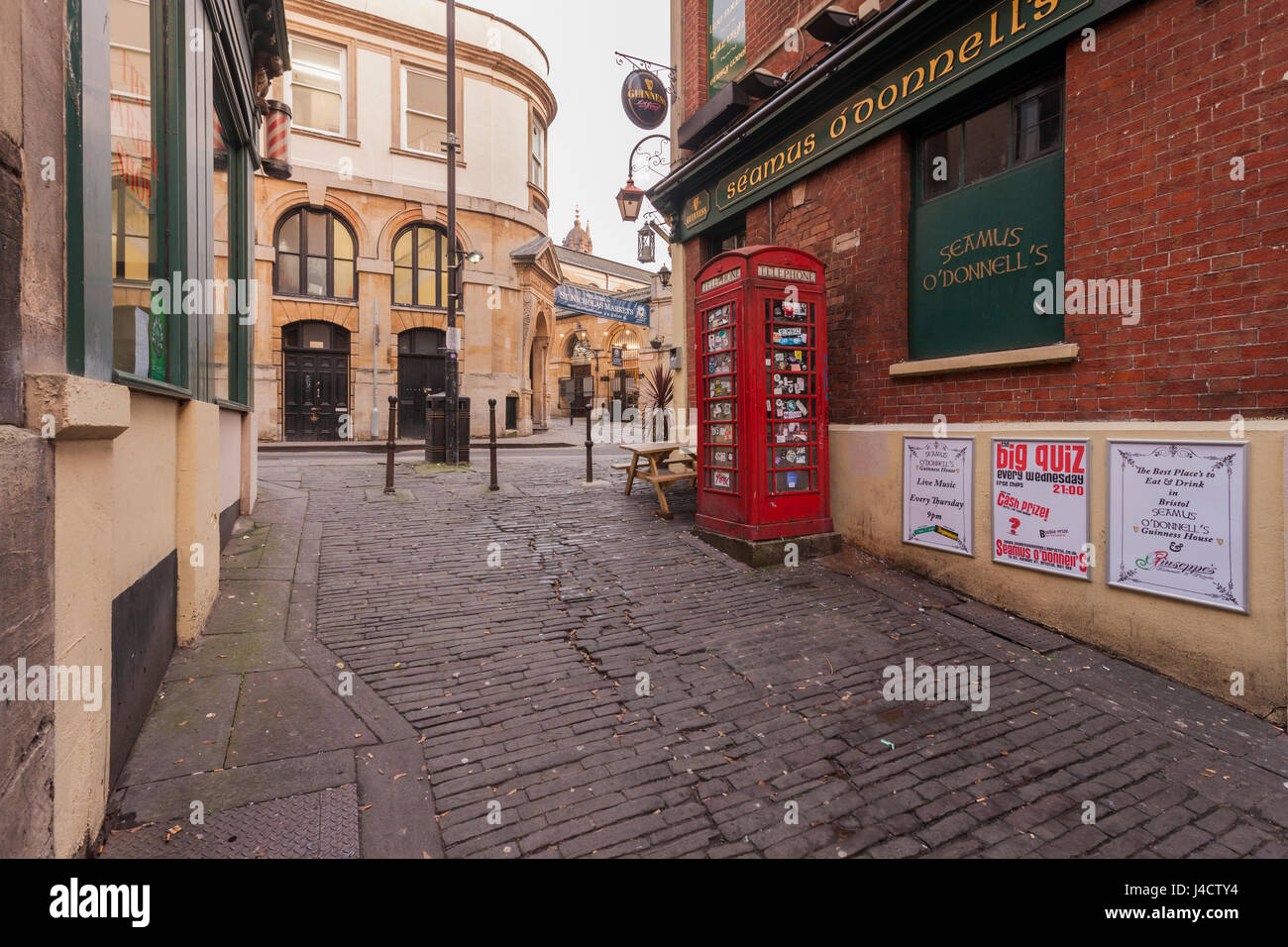 A view towards St. Nicholas Market, showing an old Red Telephone Kiosk. - Stock Image