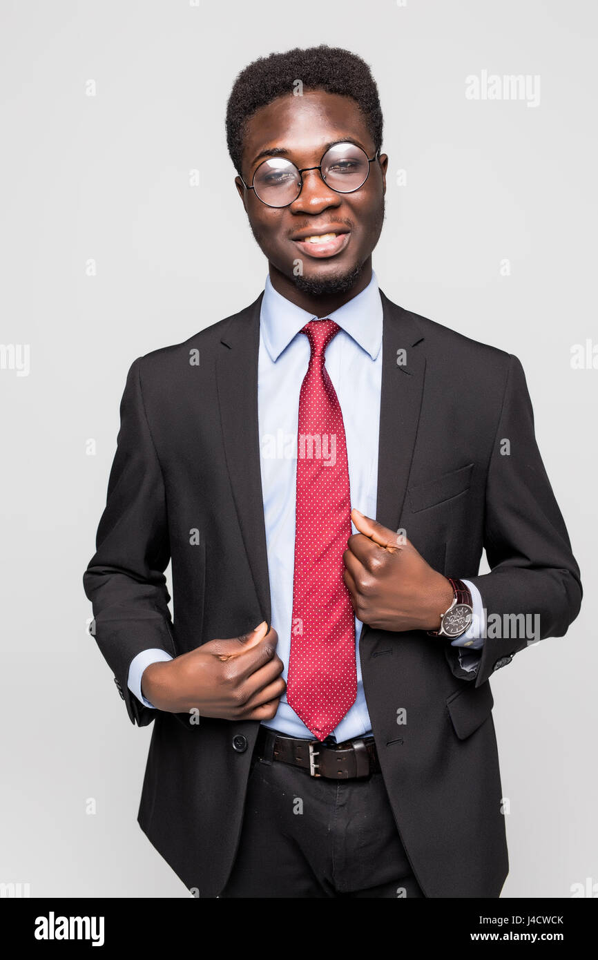 271dabc334b handsome young African American businessman wearing a black suit and tie.  Isolated on gray background
