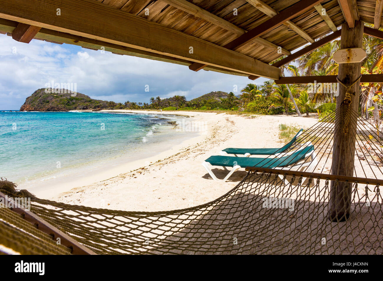 Hammock and Sun Loungers on a Secluded Caribbean Beach with Ocean