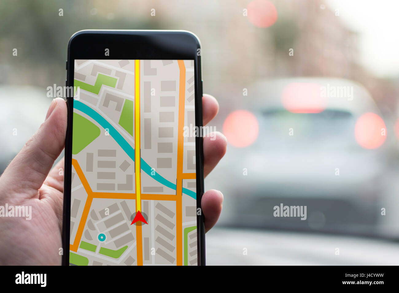 GPS Navigation on Mobile Phone Device and Transportation Concept. Male Hand Using Navigation System Map Tracking - Stock Image