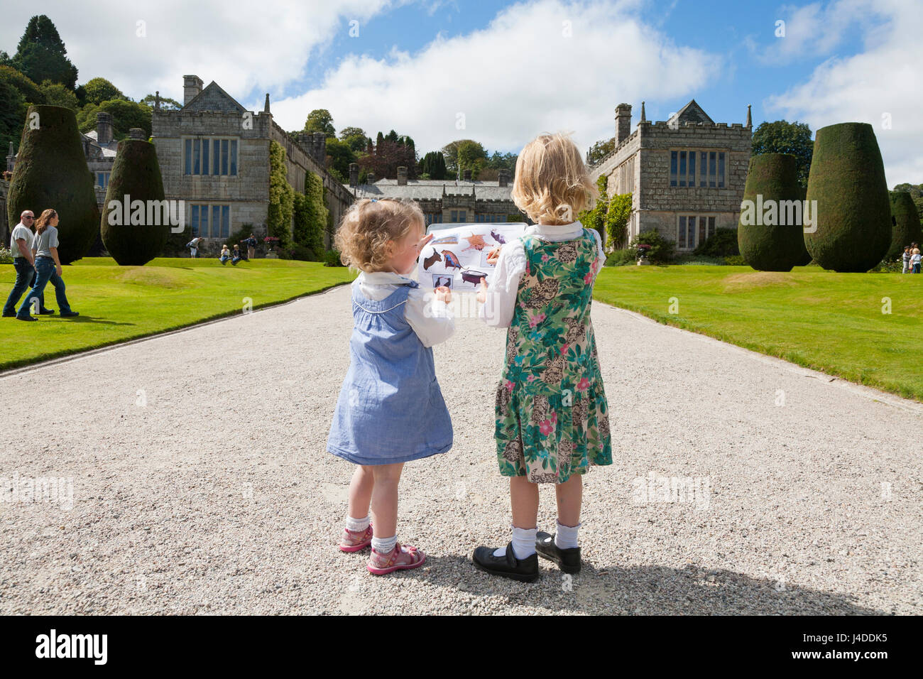 Two sisters / girls /child / children / kid / kids in the garden / Gardens at Lanhydrock, Bodmin, Cornwall. The - Stock Image