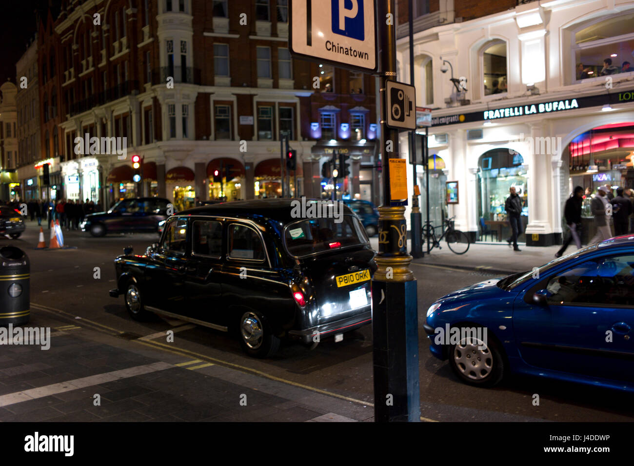 London Taxi Nightime - Stock Image