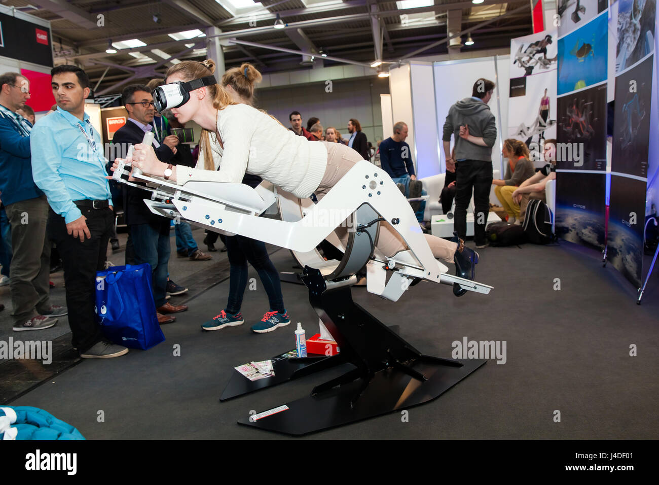 Girl in virtual reality headset on Icaros company stand on exhibition Cebit 2017 in Hannover Messe, Germany. Icaros is a full-body system with a gyroscopic design Stock Photo