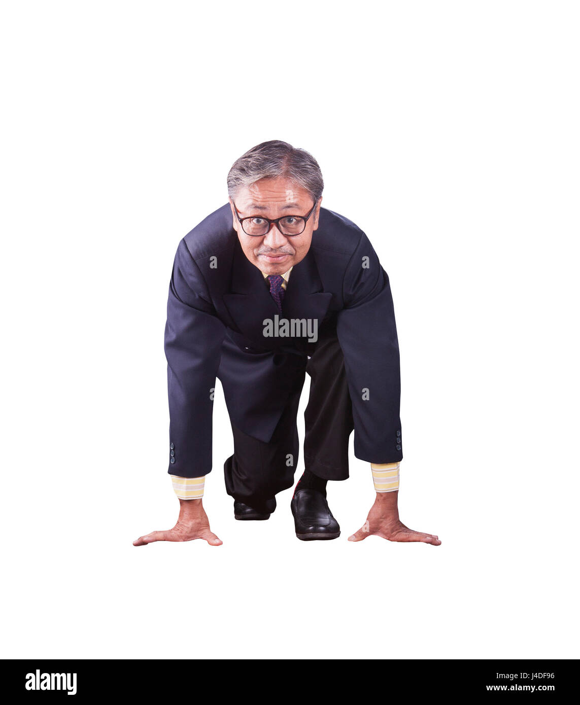 60s years asian business man posting as runner on start approach for running competition isolate white background - Stock Image