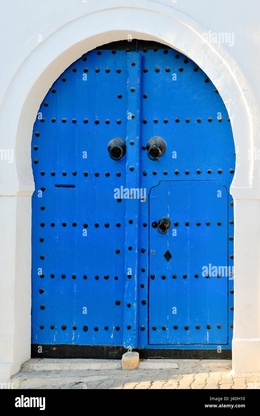 Arched Doorway with Blue Studded Door, Africa, North Africa, Tunisia, Sidi Bou Said Stock Photo