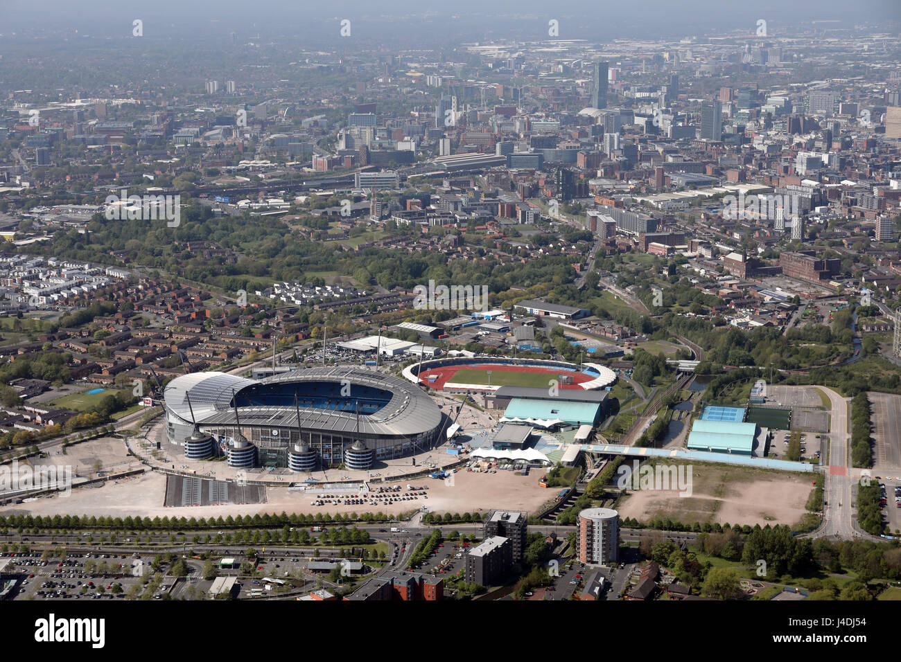 aerial view of Manchester City FC Etihad Stadium with city centre in background - Stock Image