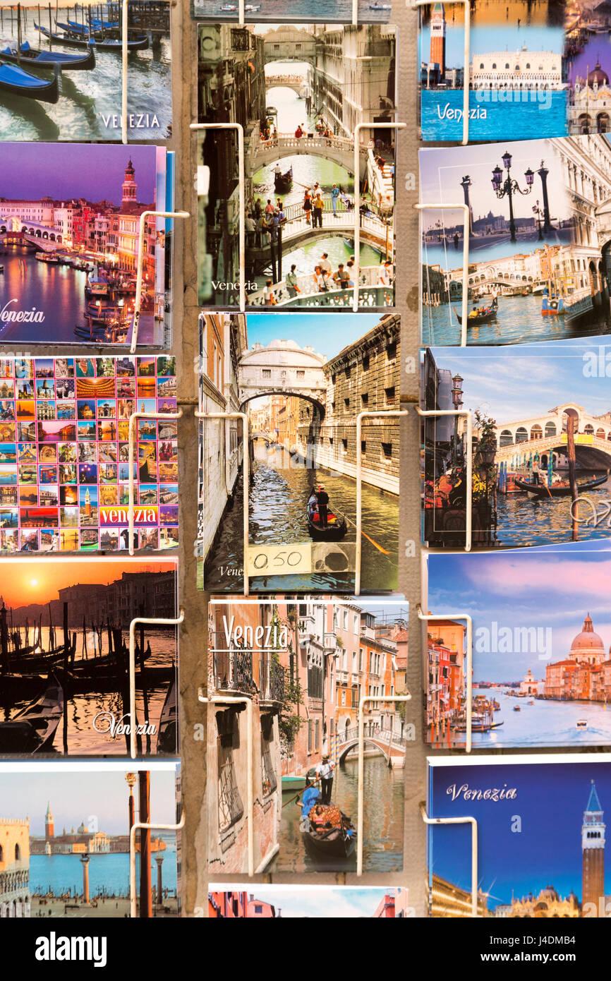 Italy, Venice, tourist souvenir postcards for sale. - Stock Image