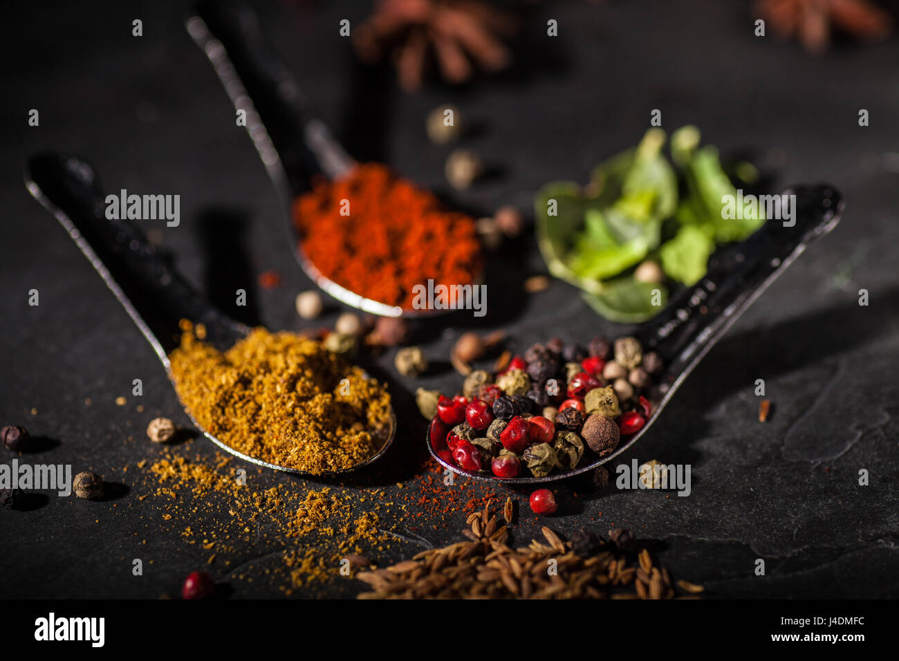 Spice selection on grey slate worktop - Stock Image