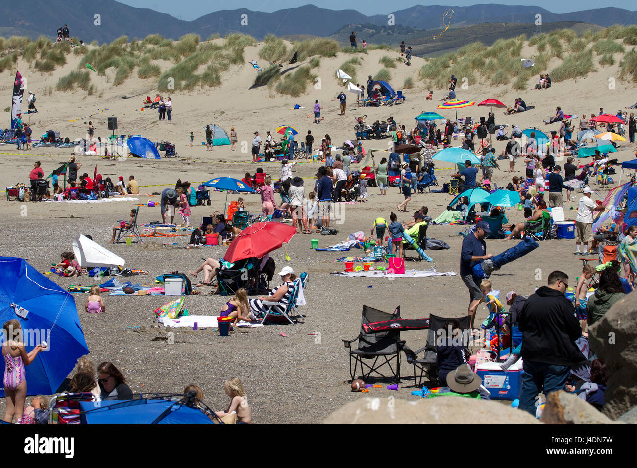 crowded beach for Kite festival - Stock Image