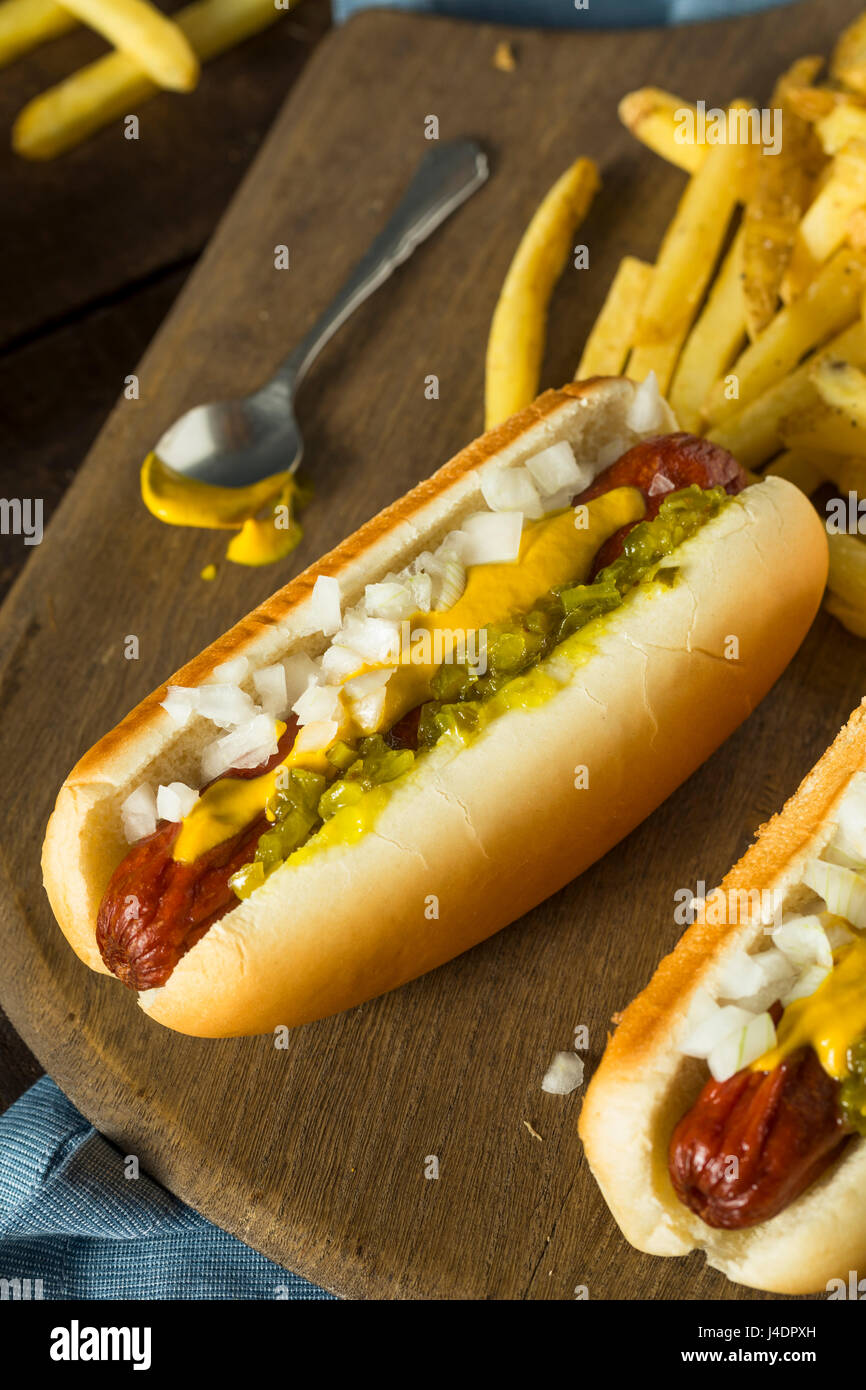 Homemade Deep Fried Hot Dogs with Mustard Onion and Relish - Stock Image