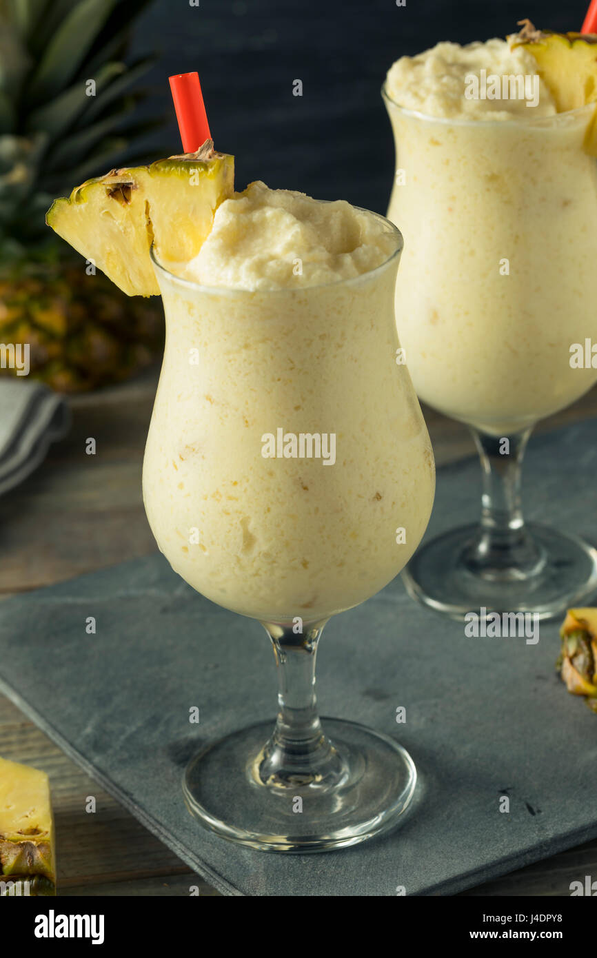 Homemade Frozen Pina Colada Cocktail with a Pineapple Garnish Stock Photo