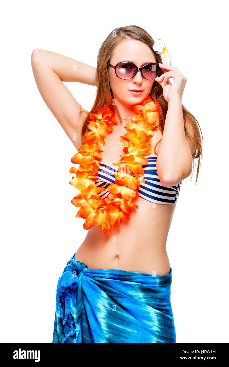 Cute model in clothes for a Hawaiian party on a white background - Stock Image
