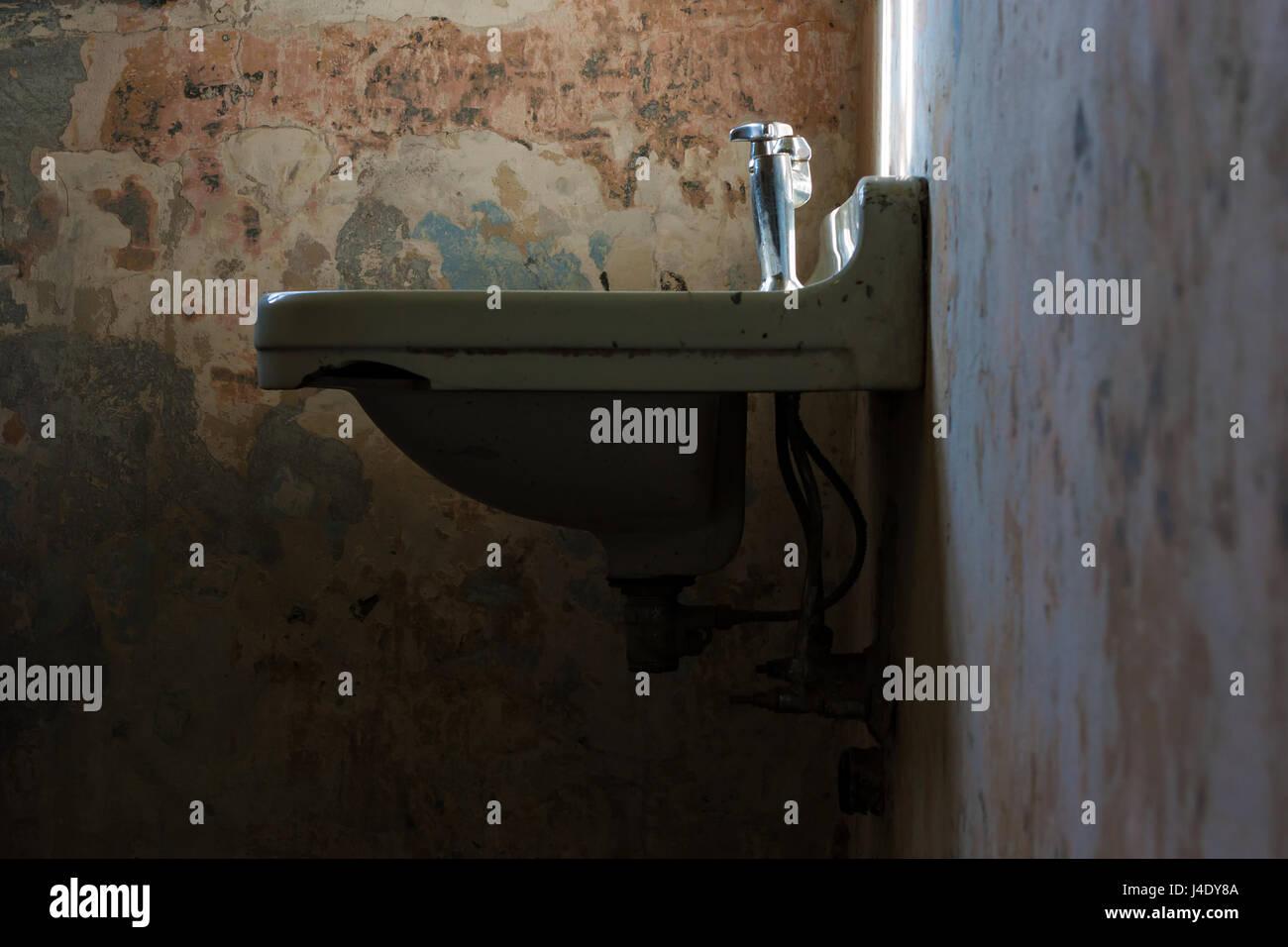Dirty, old, weathered bathroom sink. - Stock Image