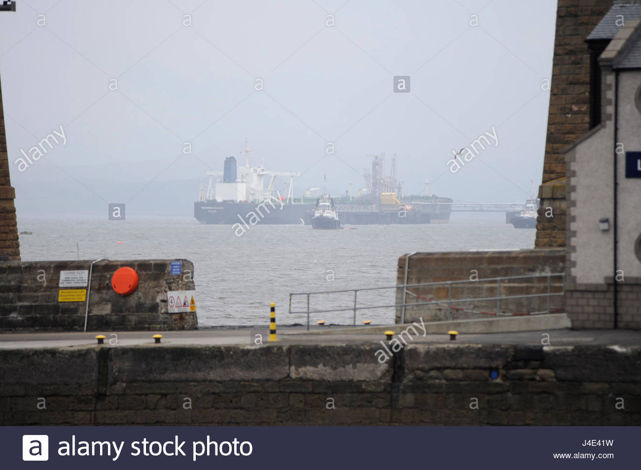 South Queensferry, UK. 12th May, 2017. UK Weather. Tanker lies alongside Hound Point oil terminal just beyond the - Stock Image