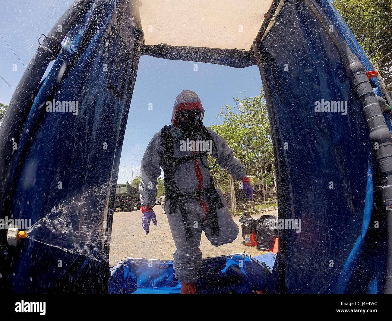 Nueva Ecija, Philippines. 12th May, 2017. A soldier from the Armed Forces of the Philippines wearing a hazmat suit - Stock Image