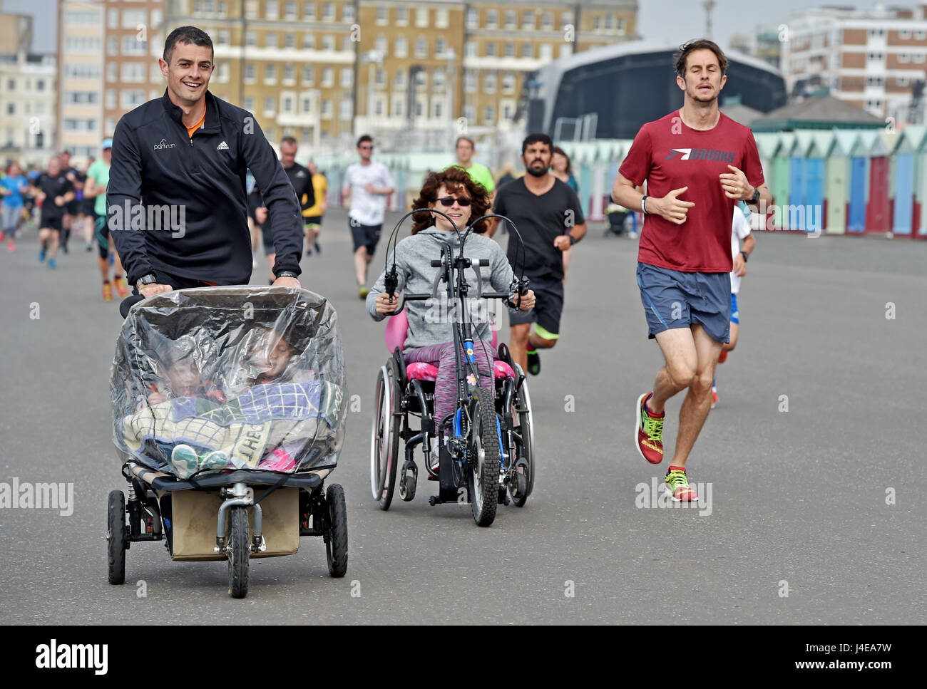 Brighton, UK. 13th May, 2017. Hundreds of people take part in the weekly Park Run fitness event along Brighton and - Stock Image