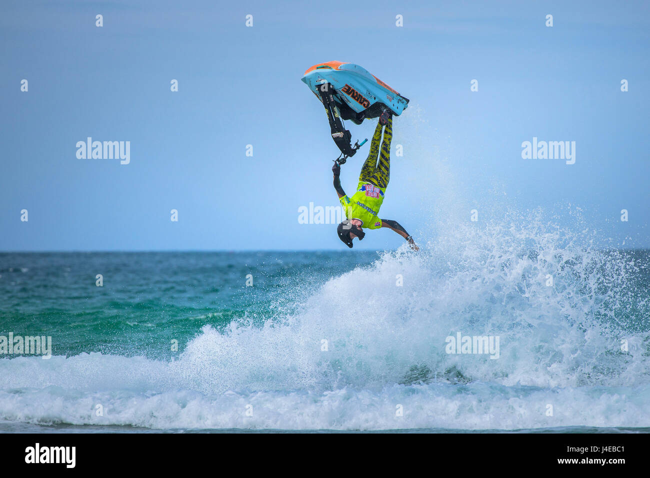 Fistral Beach; Newquay, Cornwall. 13th May, 2017. British jetski star Dan Foy performs an elegant gravity defying - Stock Image