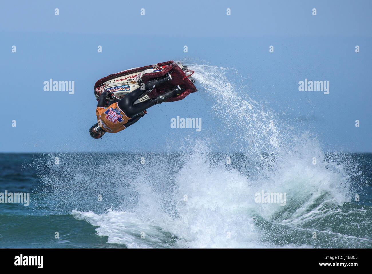 Fistral Beach; Newquay, Cornwall. 13th May, 2017.  Jetski riders perform spectacular gravity defying tricks and - Stock Image