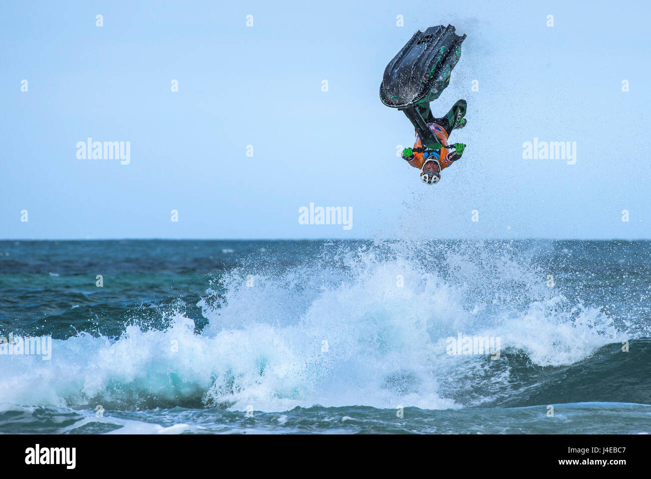 Fistral Beach; Newquay, Cornwall. 13th May, 2017.  Jetski riders perform spectacular gravity defying tricks as they - Stock Image