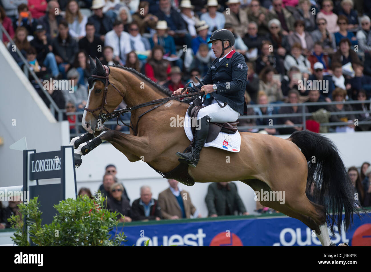 La Baule, France. 12th May, 2017. Roger Yves Bost riding Sangria du Coty during the Nations Cup in La Baule, France - Stock Image
