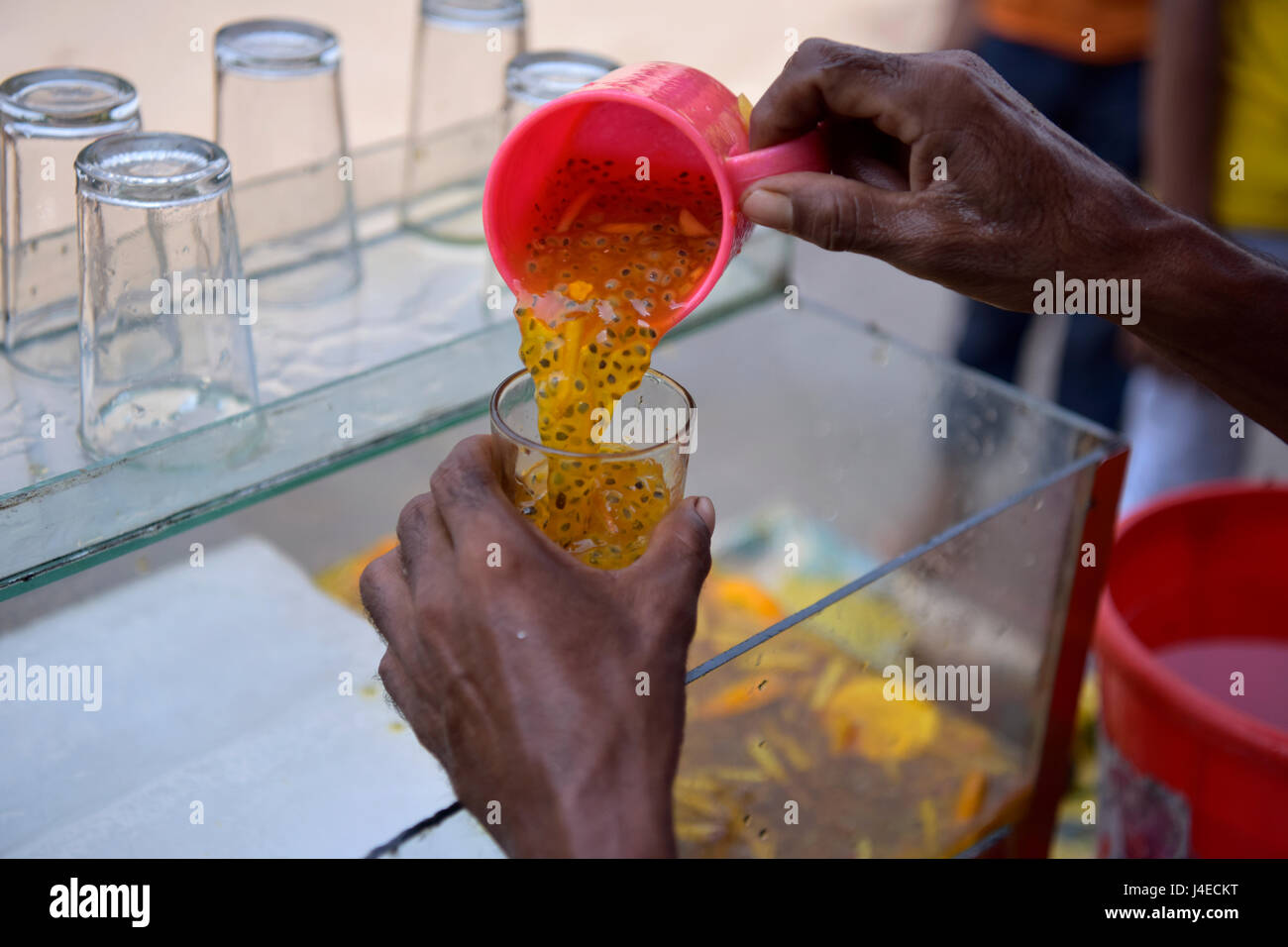 DHAKA, BANGLADESH - MAY 13, 2017: A Bangladeshi street vendor sells unhygienic cold fruit juice in Dhaka, Bangladesh. - Stock Image