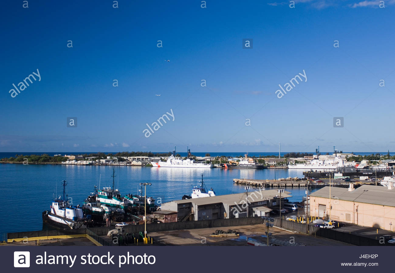 Coast Guard Cutter at dock at the Coast Guard station on Sand Island, Honolulu Harbor, Oahu, Hawaii, USA - Stock Image