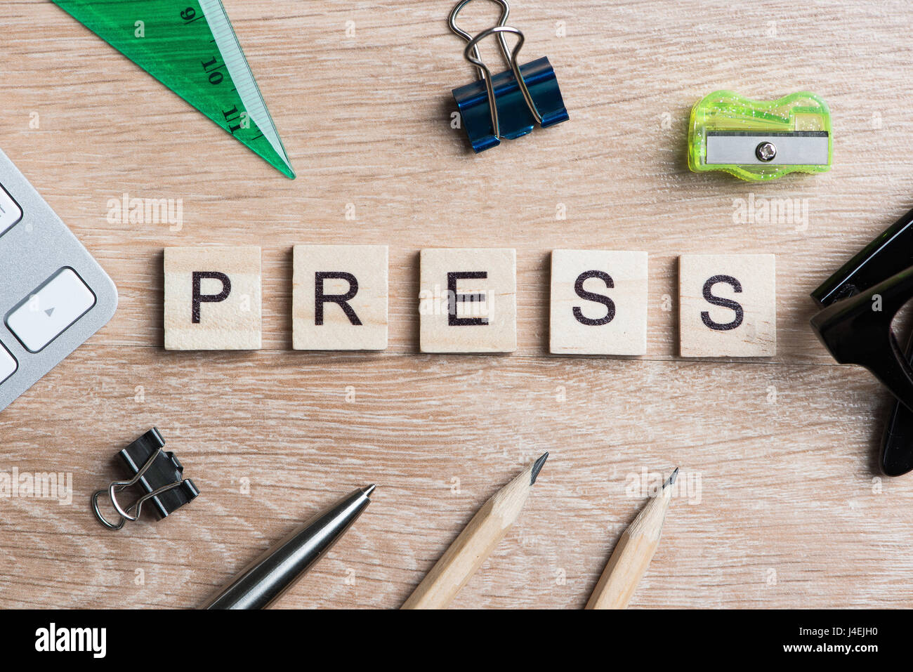 Mass media conceptual words spelled with wooden cubes on desk - Stock Image