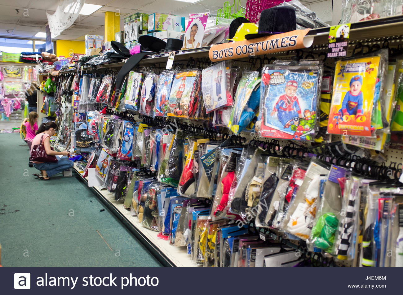 halloween costumes shop stock photos & halloween costumes shop stock