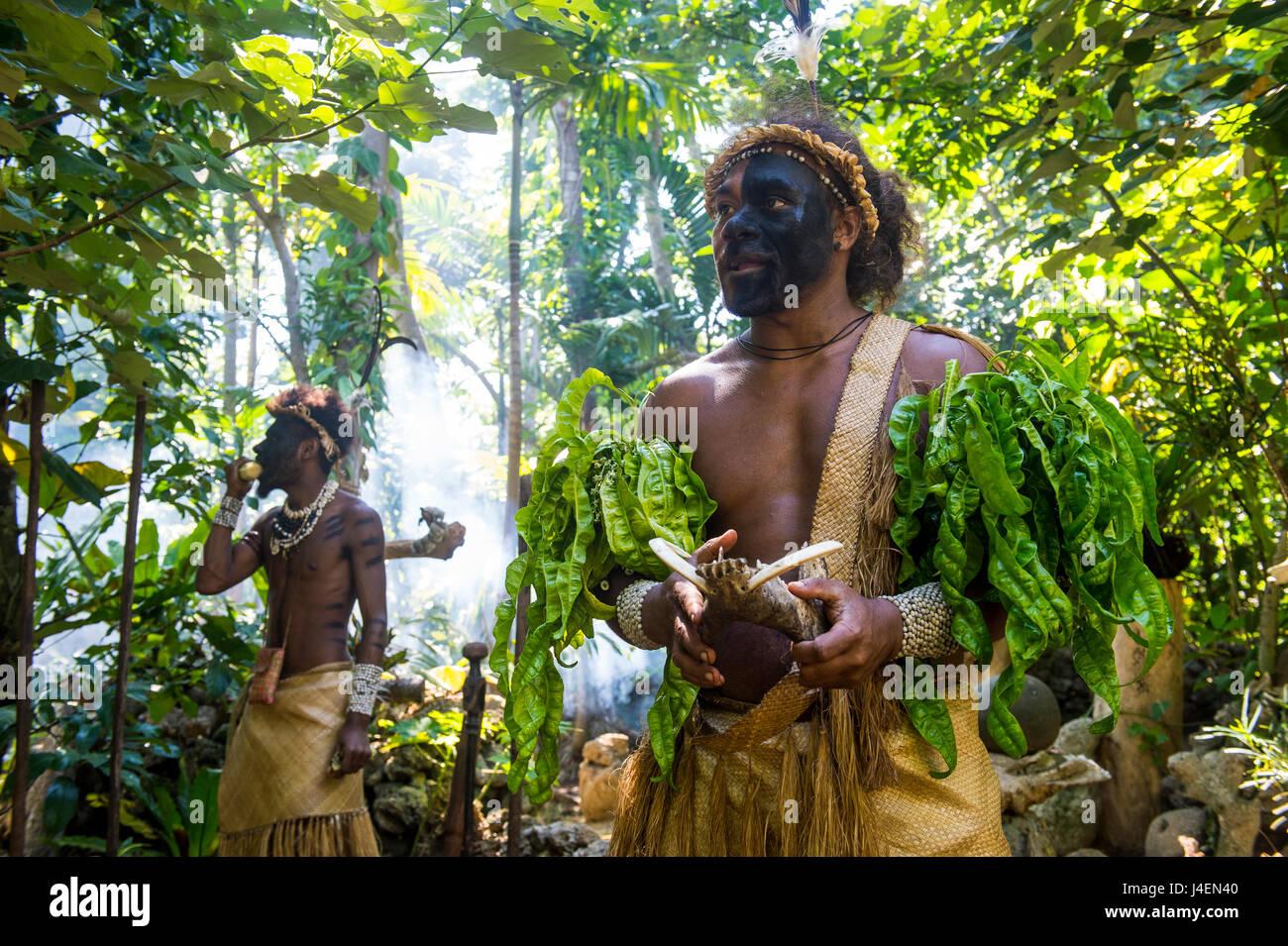 Traditional dressed man in the jungle, Ekasup Cultural Village, Efate, Vanuatu, Pacific - Stock Image