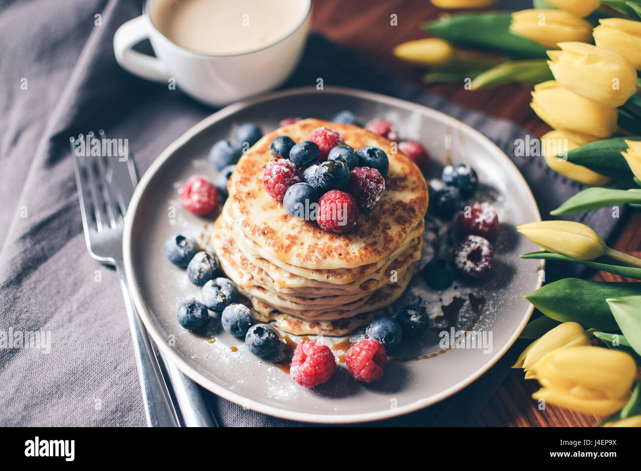 Breakfast variations. Pancakes with berries and stroop syrup. - Stock Image