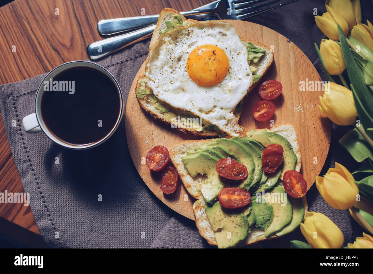 Breakfast variations. Avocado on a toasted bread. - Stock Image