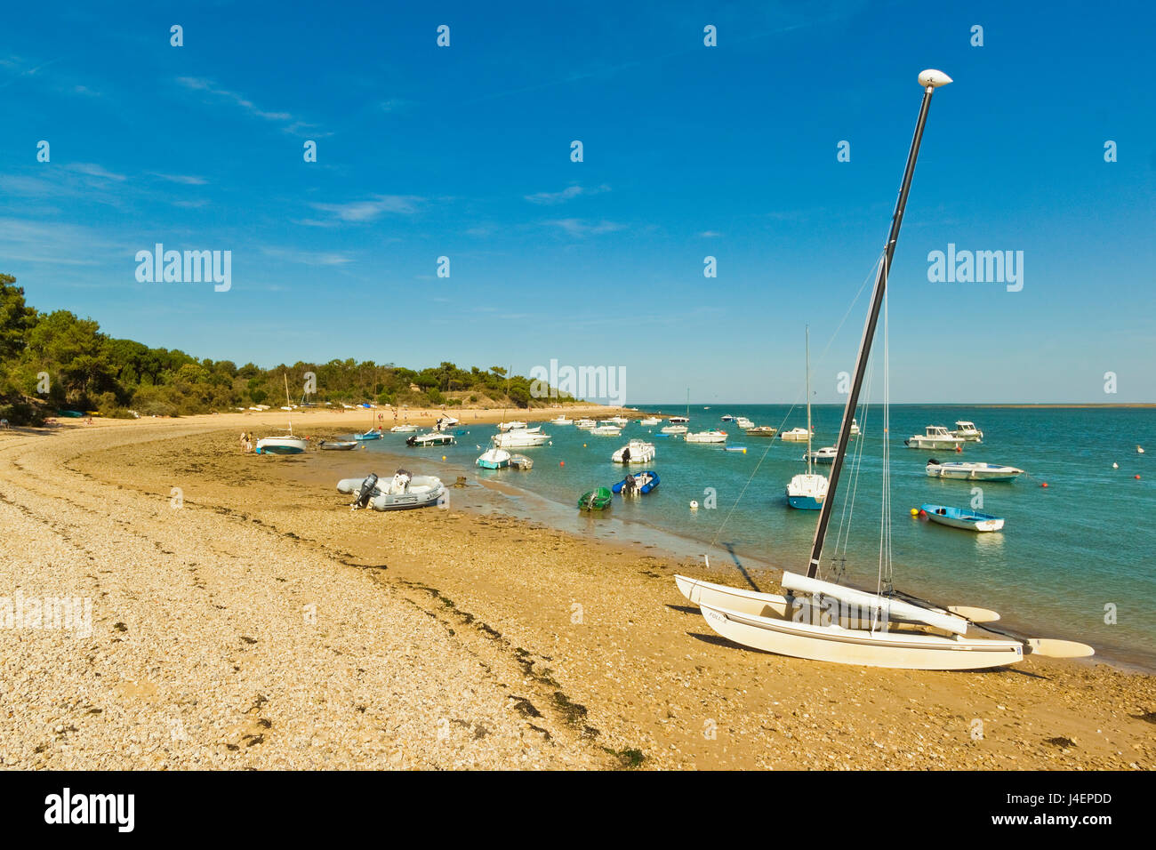 Boats moored in the entrance to Fier d Ars by the beach at La Patache, Les Portes-en-Re, Ile de Re, Charente-Maritime, - Stock Image