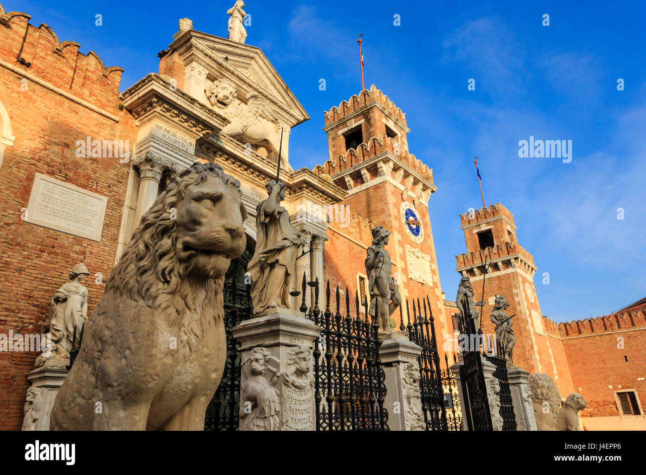Carved lions and statues, Porta Magna, Arsenale, in winter afternoon sun, Castello, Venice, UNESCO, Veneto, Italy - Stock Image