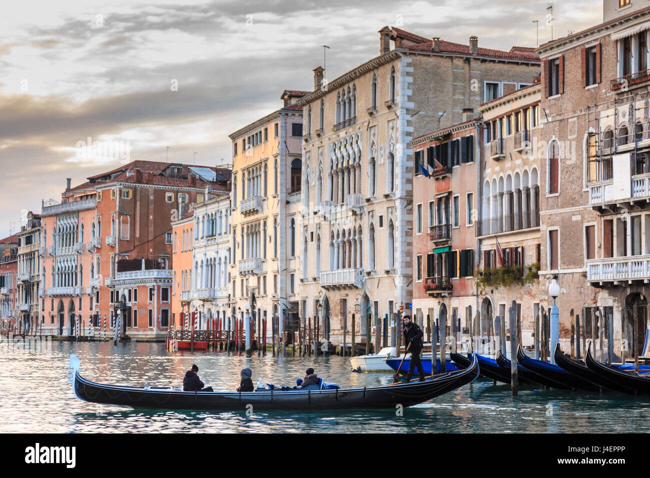 Gondola, La Volta, Grand Canal, elaborate Gothic palazzi at sunset in winter, Venice, UNESCO World Heritage Site, - Stock Image