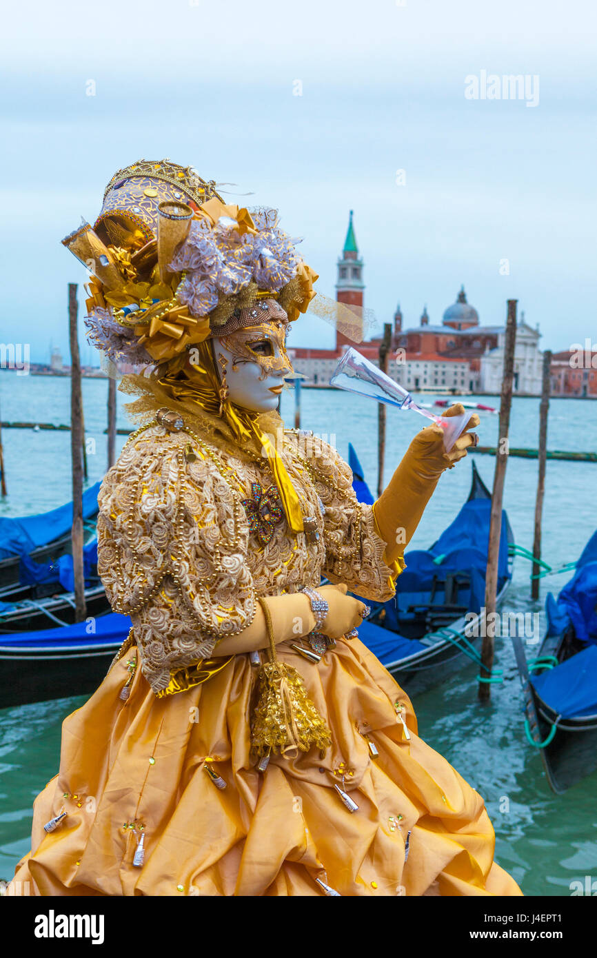 Colourful mask and costume of the Carnival of Venice, famous festival worldwide, Venice, Veneto, Italy, Europe - Stock Image