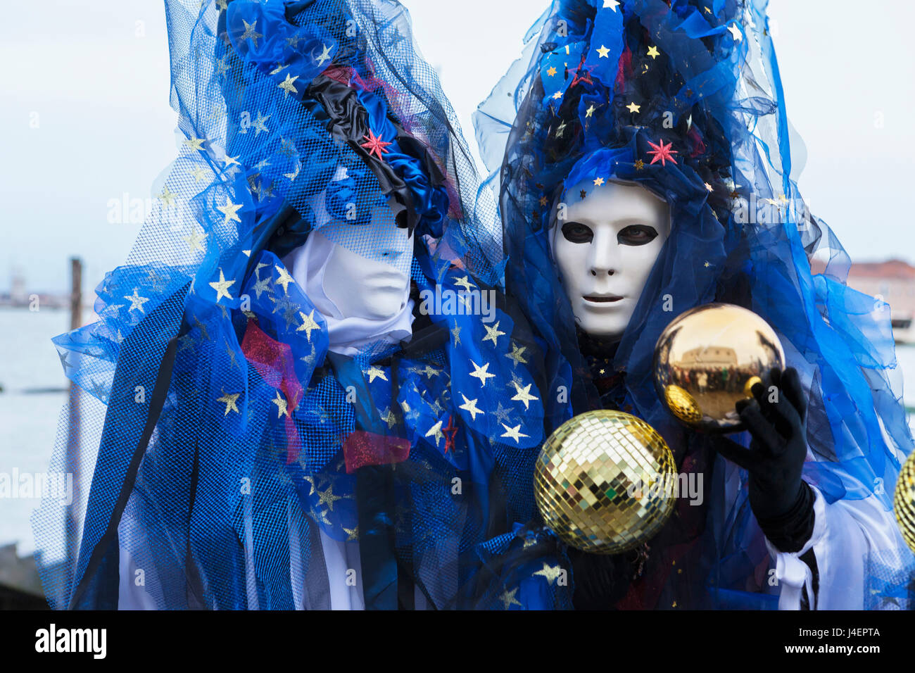 Colourful masks and costumes of the Carnival of Venice, famous festival worldwide, Venice, Veneto, Italy, Europe - Stock Image