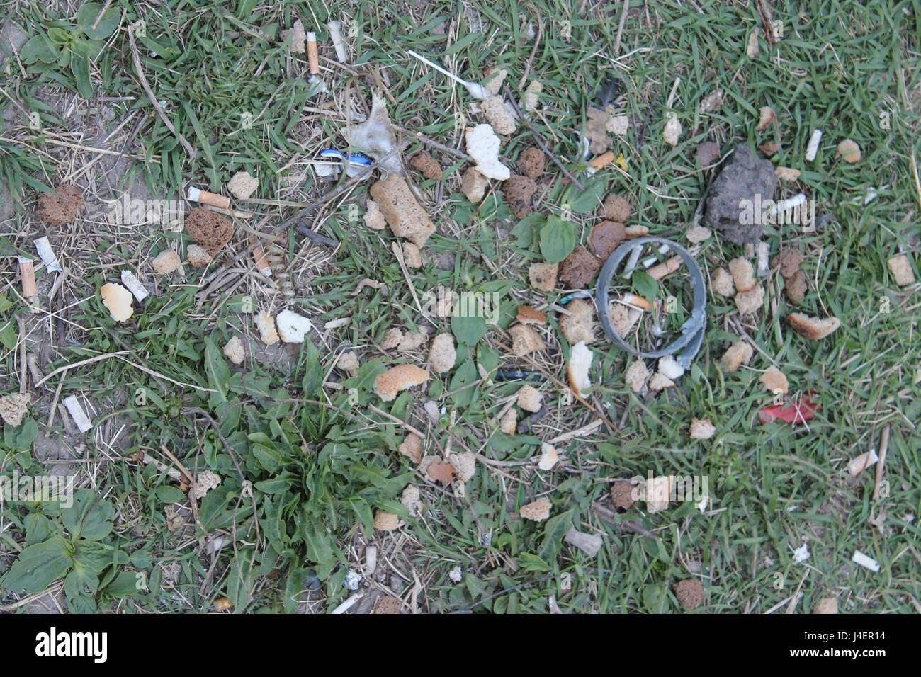Endless waste trash garbage dumping ground grass - Stock Image
