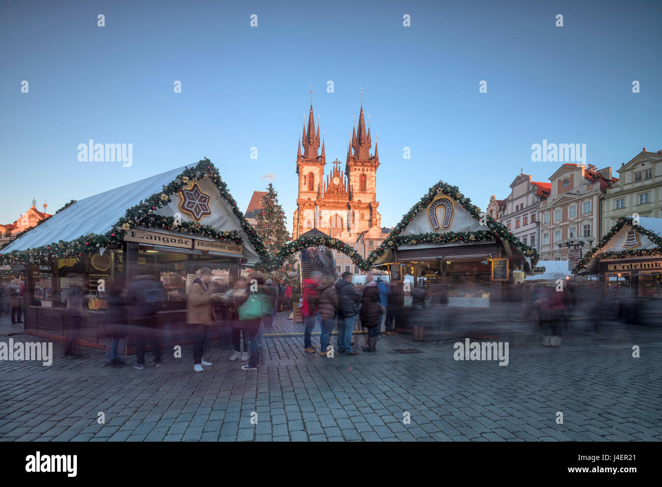 Tourists at the Christmas markets facing the Cathedral of St. Vitus, Old Town Square, Prague, Czech Republic, Europe - Stock Image