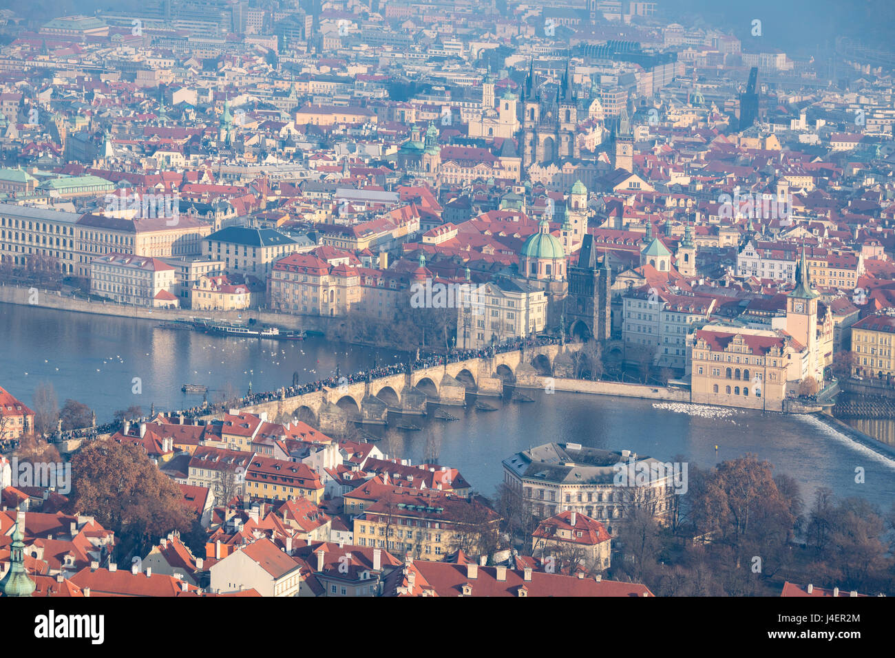 View of typical buildings and ancient churches framed by the River Vltava, Prague, Czech Republic, Europe - Stock Image