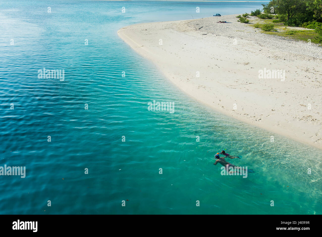 Man snorkeling in the beautiful lagoon of Ouvea, Loyalty Islands, New Caledonia, Pacific - Stock Image