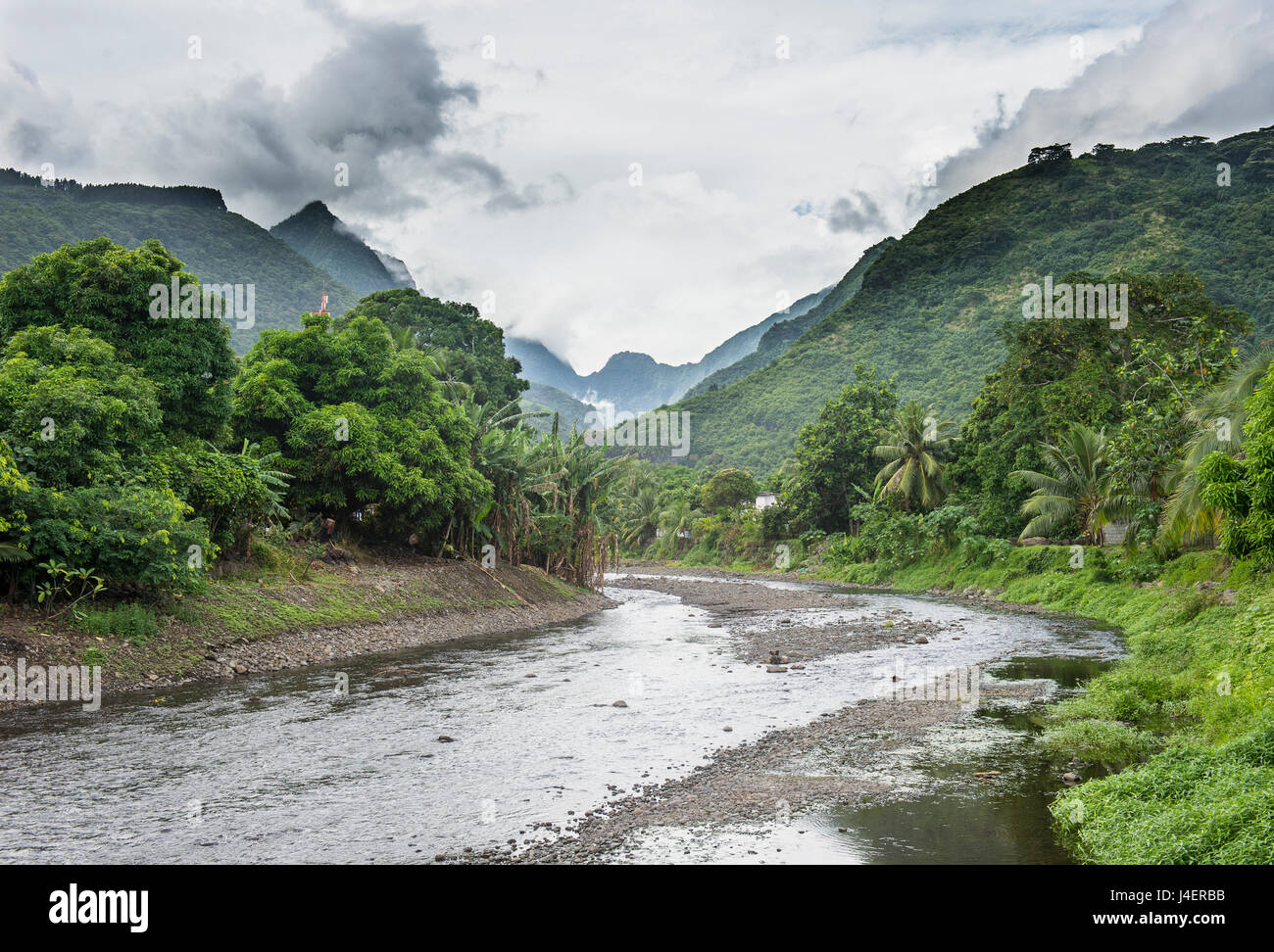 Paea River with dramatic mountains in the background, Tahiti, Society Islands, French Polynesia, Pacific - Stock Image