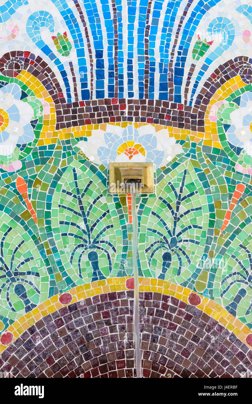 Close up of the mosaic fountain of the original source of Evian spring water, Évian-les-Bains, France - Stock Image