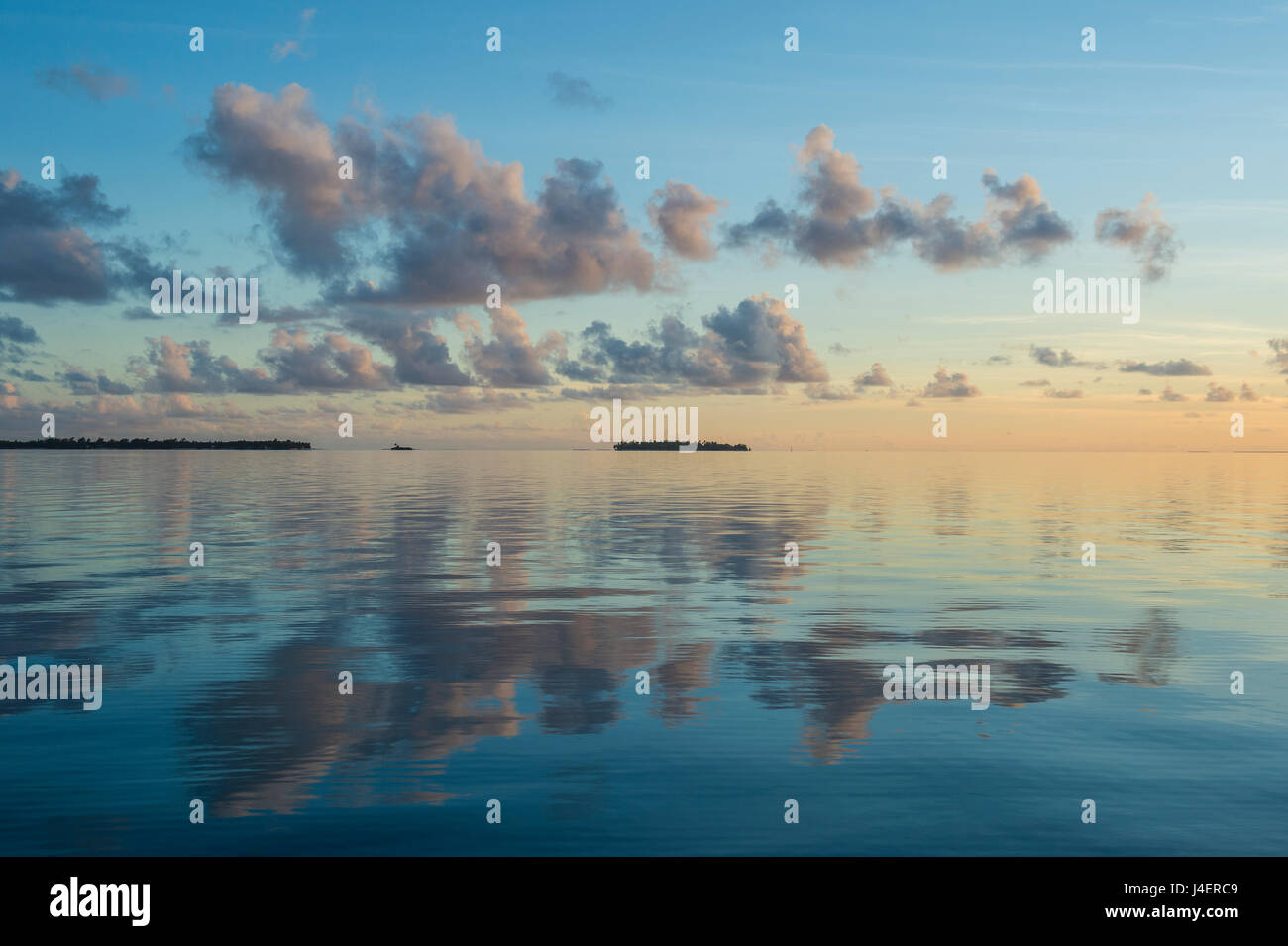 Sunset over the calm waters of Tikehau, Tuamotus, French Polynesia, Pacific - Stock Image
