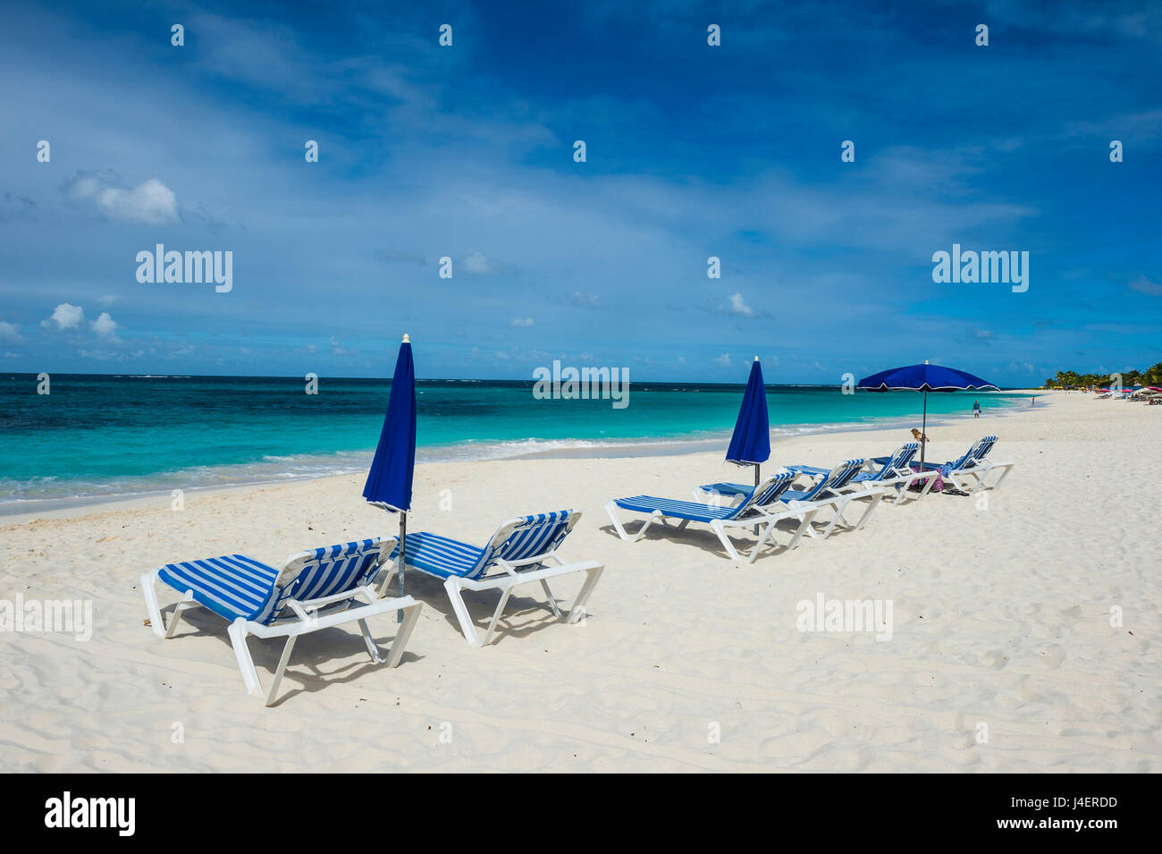 Sun loungers on world class Shoal Bay East beach, Anguilla, British Oversea territory, West Indies, Caribbean, Central - Stock Image