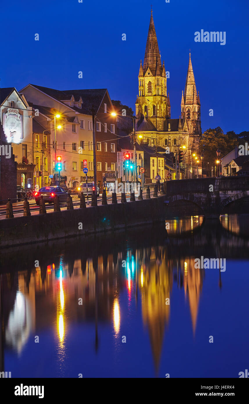 A dusk view of St. Fin Barre's Cathedral, on the banks of the Lee River, in Cork, County Cork, Munster, Republic - Stock Image