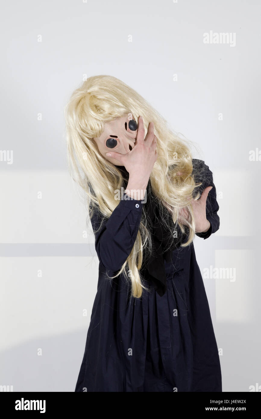 Alien witch wearing a blond wig - Stock Image
