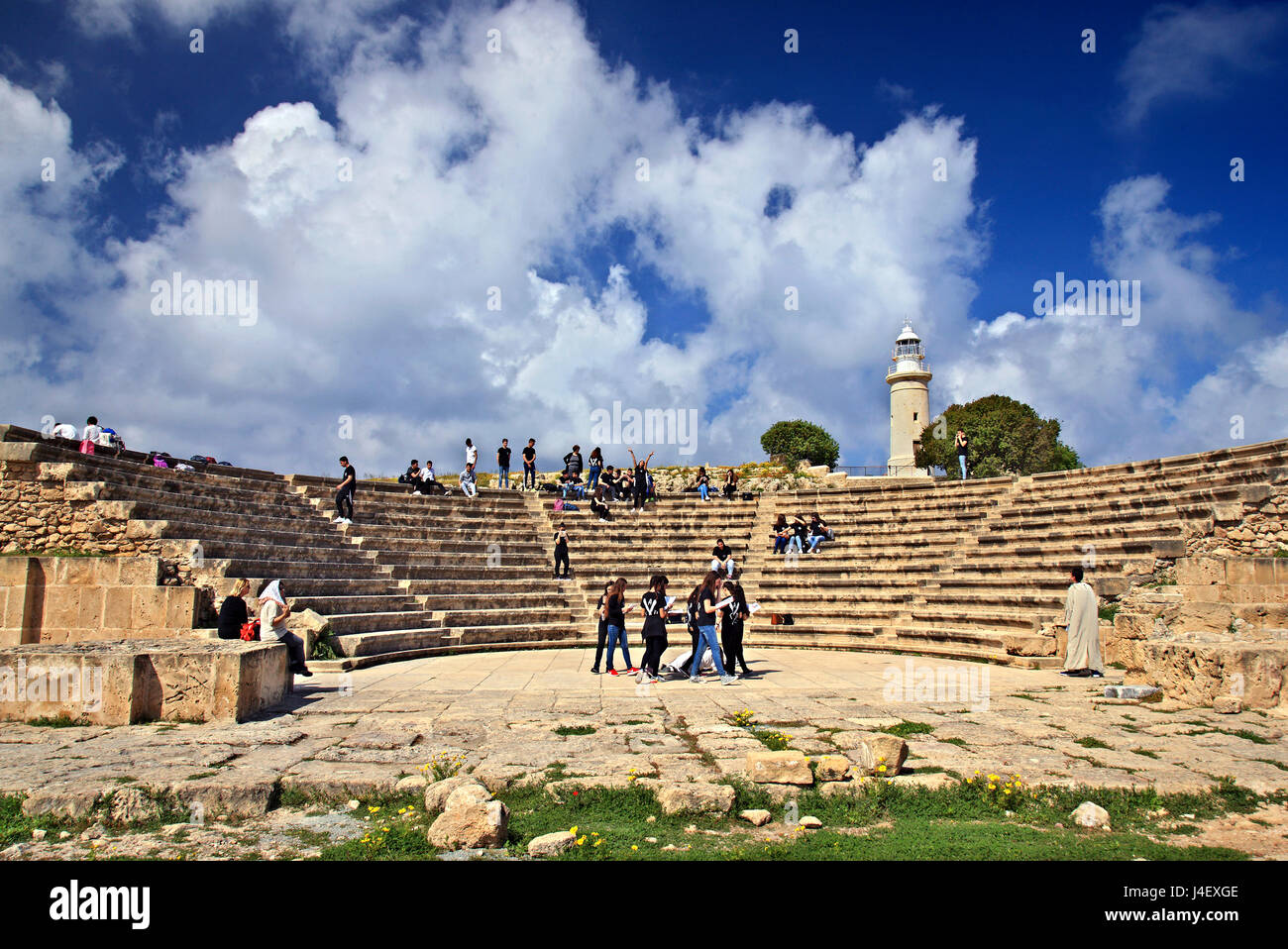 Students, 'rehearsing' at the Roman Odeon in the Archaeological Park of Paphos (UNESCO World Heritage Site) - Stock Image
