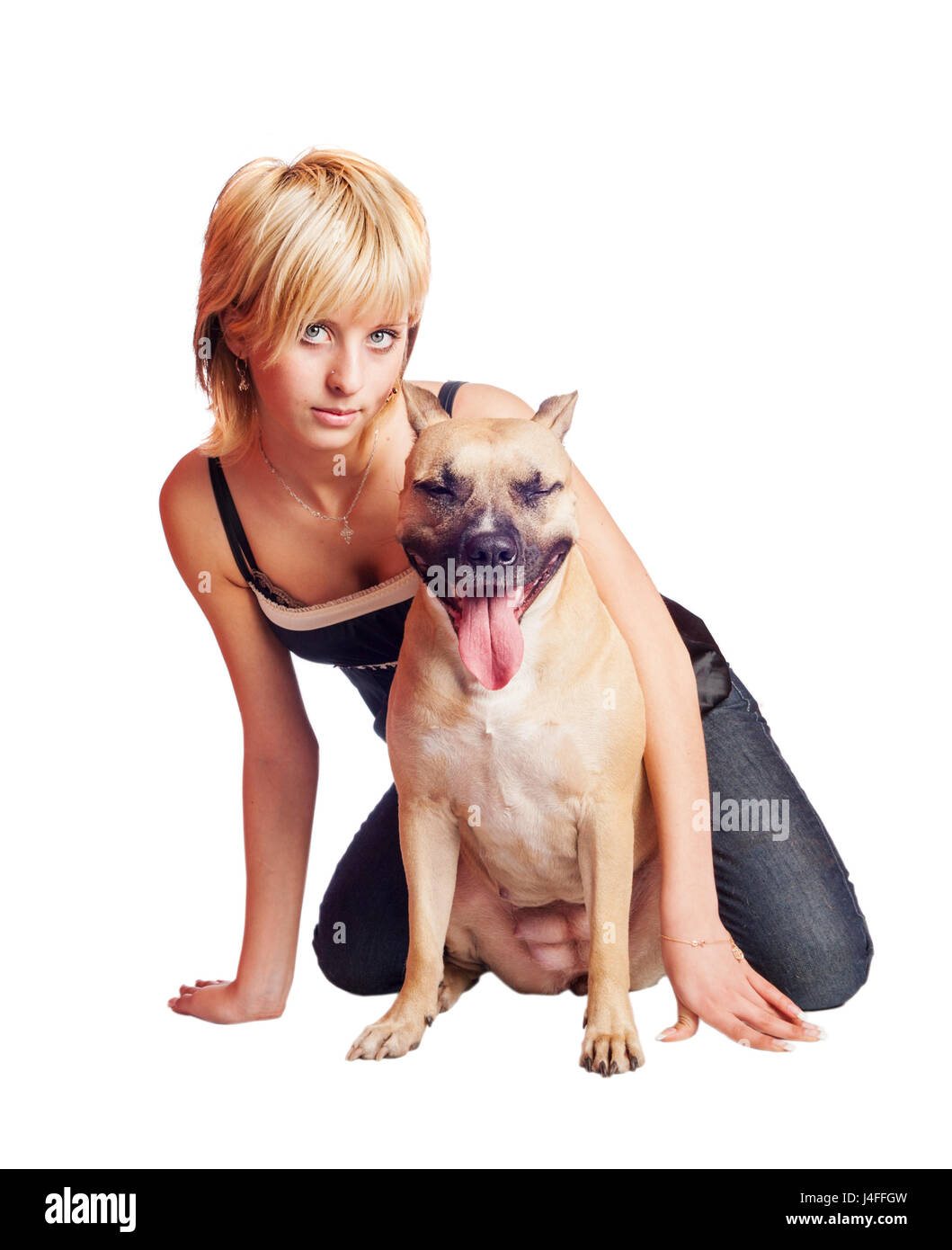 Woman and dog sitting together Fighting dog terrier and woman  isolated on white - Stock Image