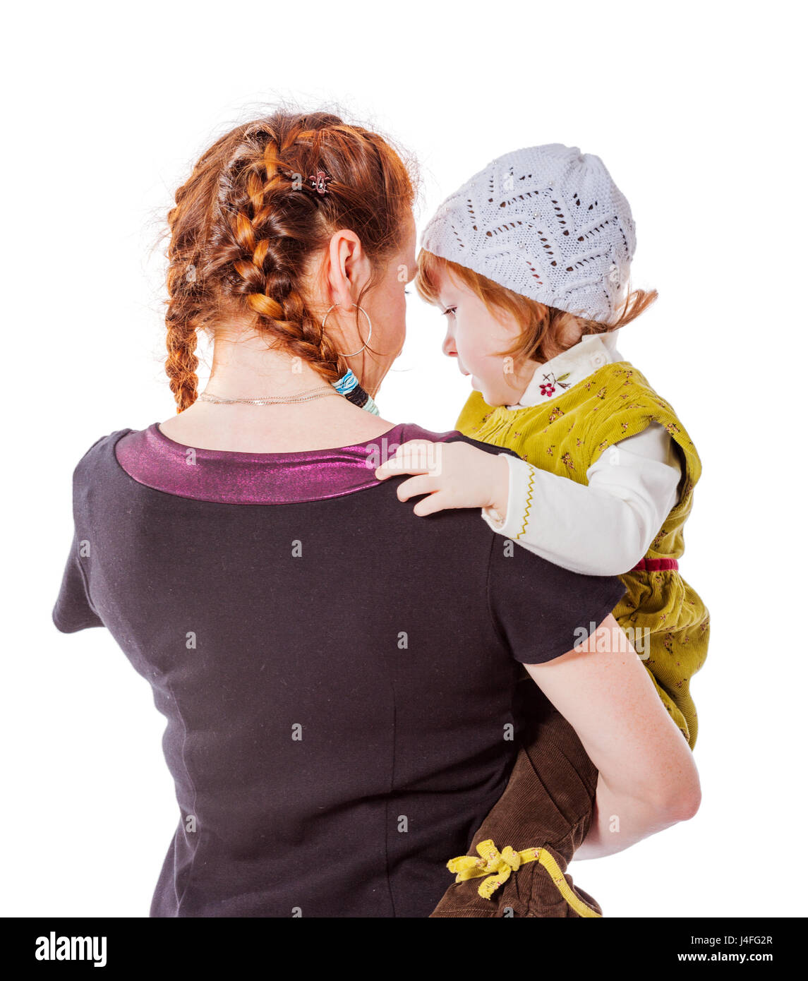 Mother with daughter sharing secrets back view isolated - Stock Image